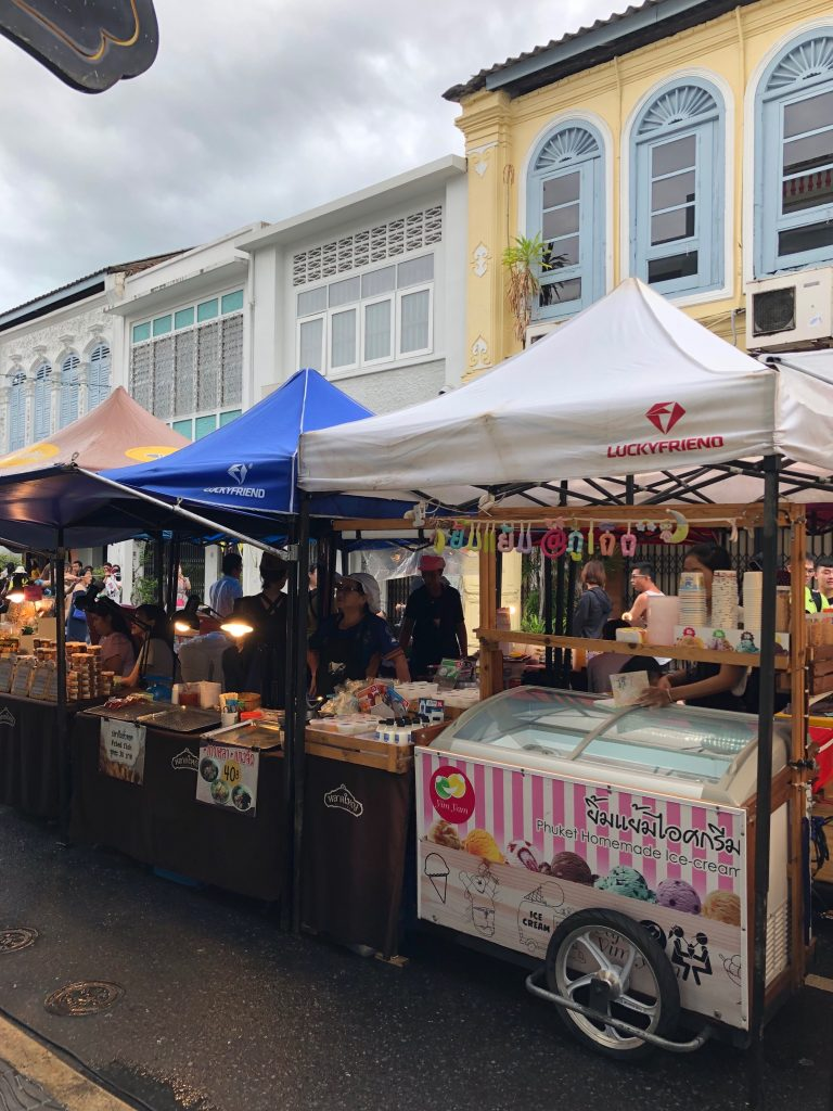 Colourful food stalls line the centre of a street