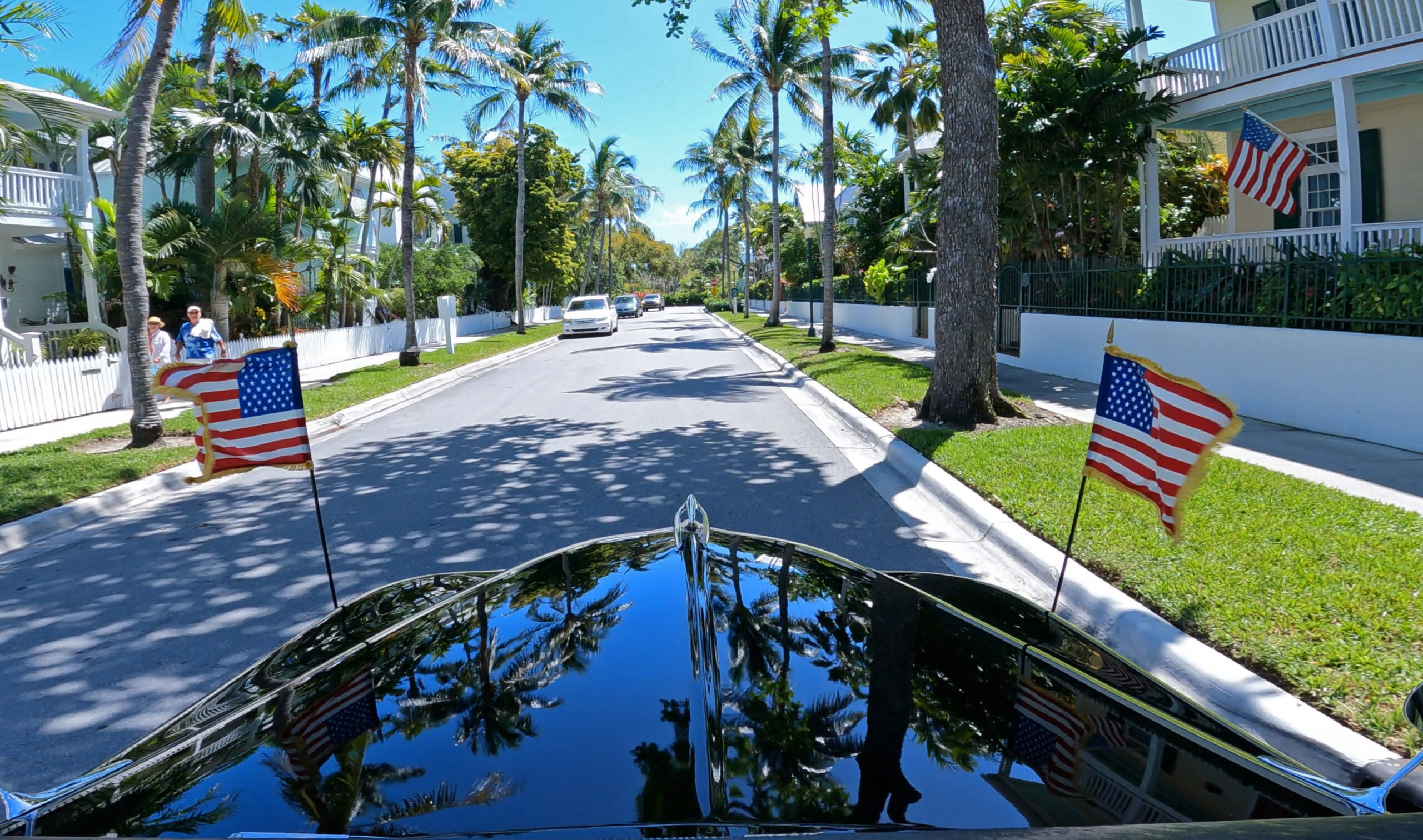 """This photo shows the view out the front windshield of a presidential limousine once used by President Harry S. Truman as it rolls down a street Thursday, March 11, 2021, in Key West, Fla. A ride in the limo, one of the vehicles that transported Truman during his 1945-1953 presidency, is part of the Key West Harry S. Truman Little White House Museum's recently debuted """"White Glove Tour,"""" providing small groups views of Truman objects not on public display. America's 33rd president spent nearly six months in Key West spread over 11 visits while in office. FOR EDITORIAL USE ONLY (Steve Panariello/Florida Keys News Bureau/HO)"""